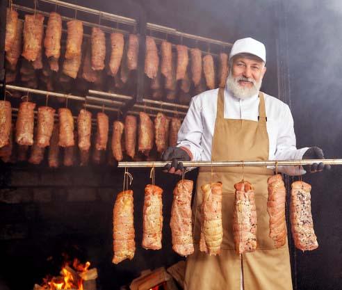 Master Artisanal Charcutier in the smokehouse